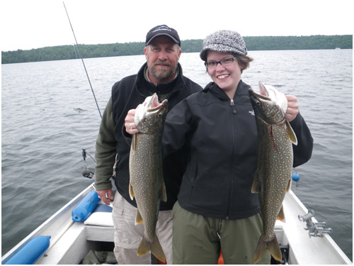 A good catch: two fish on the Lake Memphremagog during a fishing day with the Destination Le Mirage Outfitter